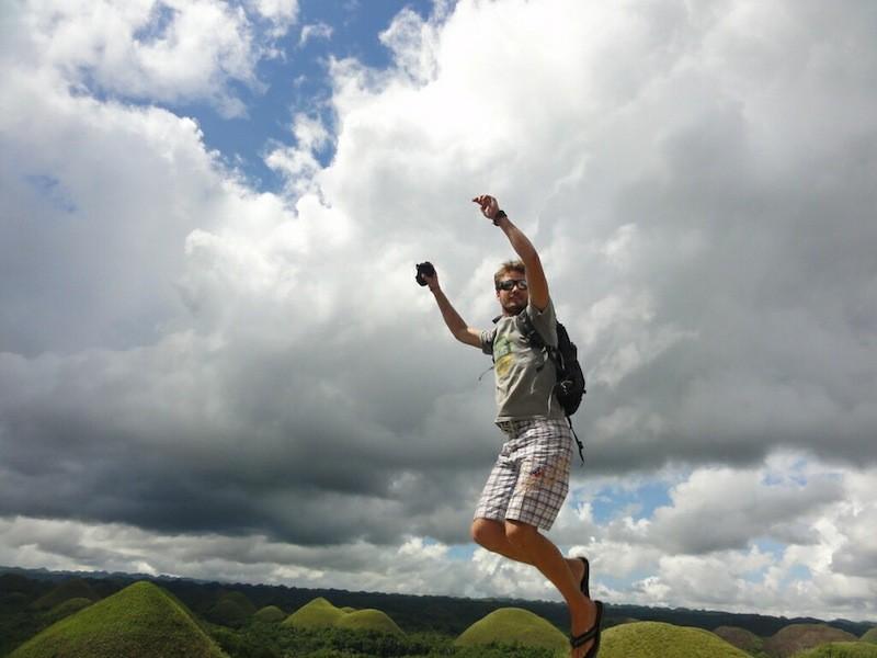 Bastiaan jumping at the Chocolate Hills in Bohol