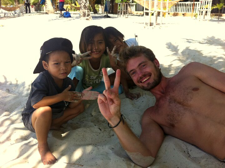 Bastiaan and local kids at a beach in Malapascua Island, Cebu