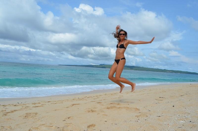 Alexandra jumping for joy in Puka Beach, Boracay