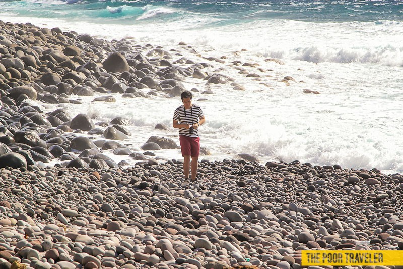 Swim and the waves will smash you onto the boulders. Keep walking!